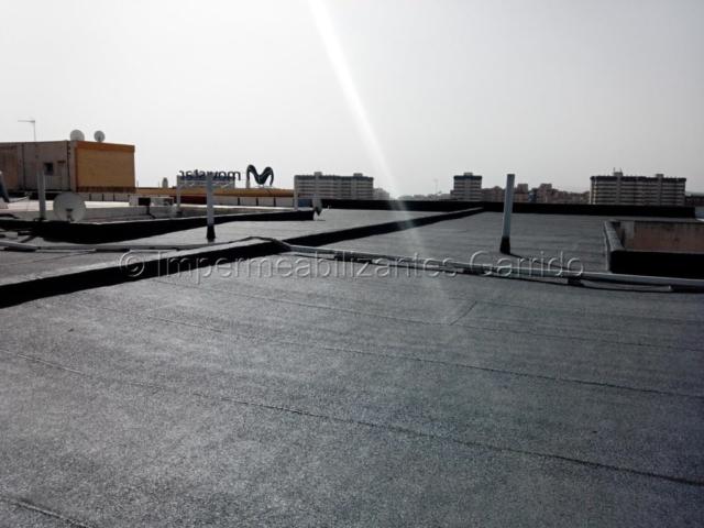 Impermeabilización de terrazas y cubiertas de vecinos Impermeabilizantes Garrido